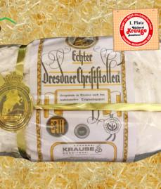 Dresdner Christstollen auf Holzwolle bei Alpen Sepp